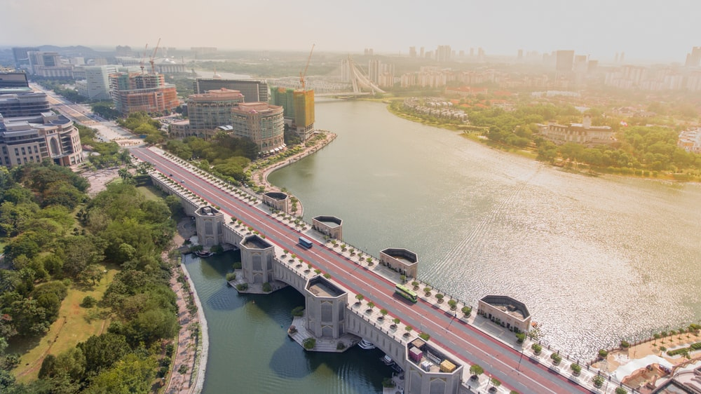 aerial photography of gray and red concrete road bridge