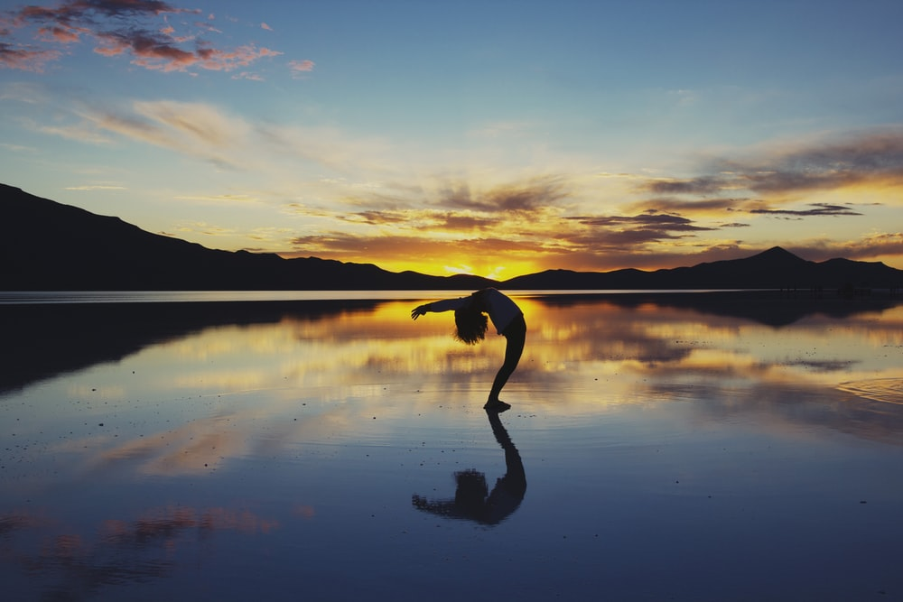 silhouette photography of woman doing yoga