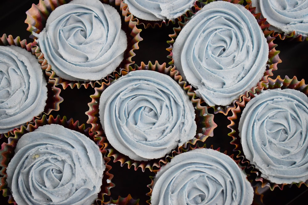 top view of cupcakes topped with blue icings