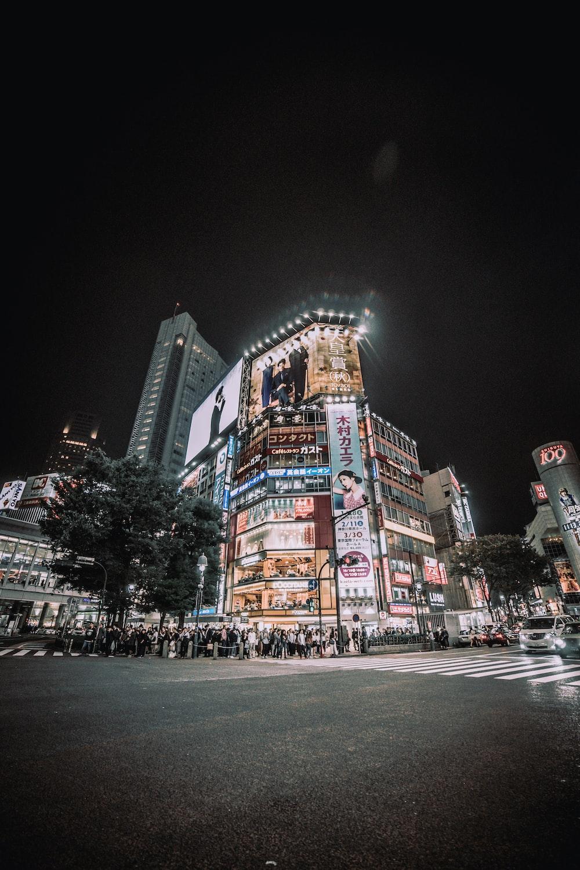 people passing through the pedestrian lane during nighttime