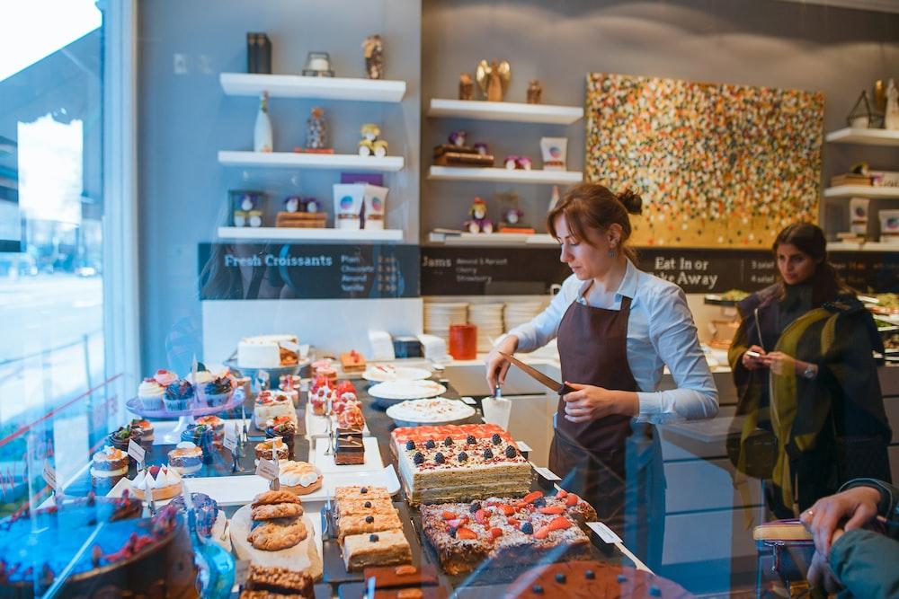 woman slicing cake