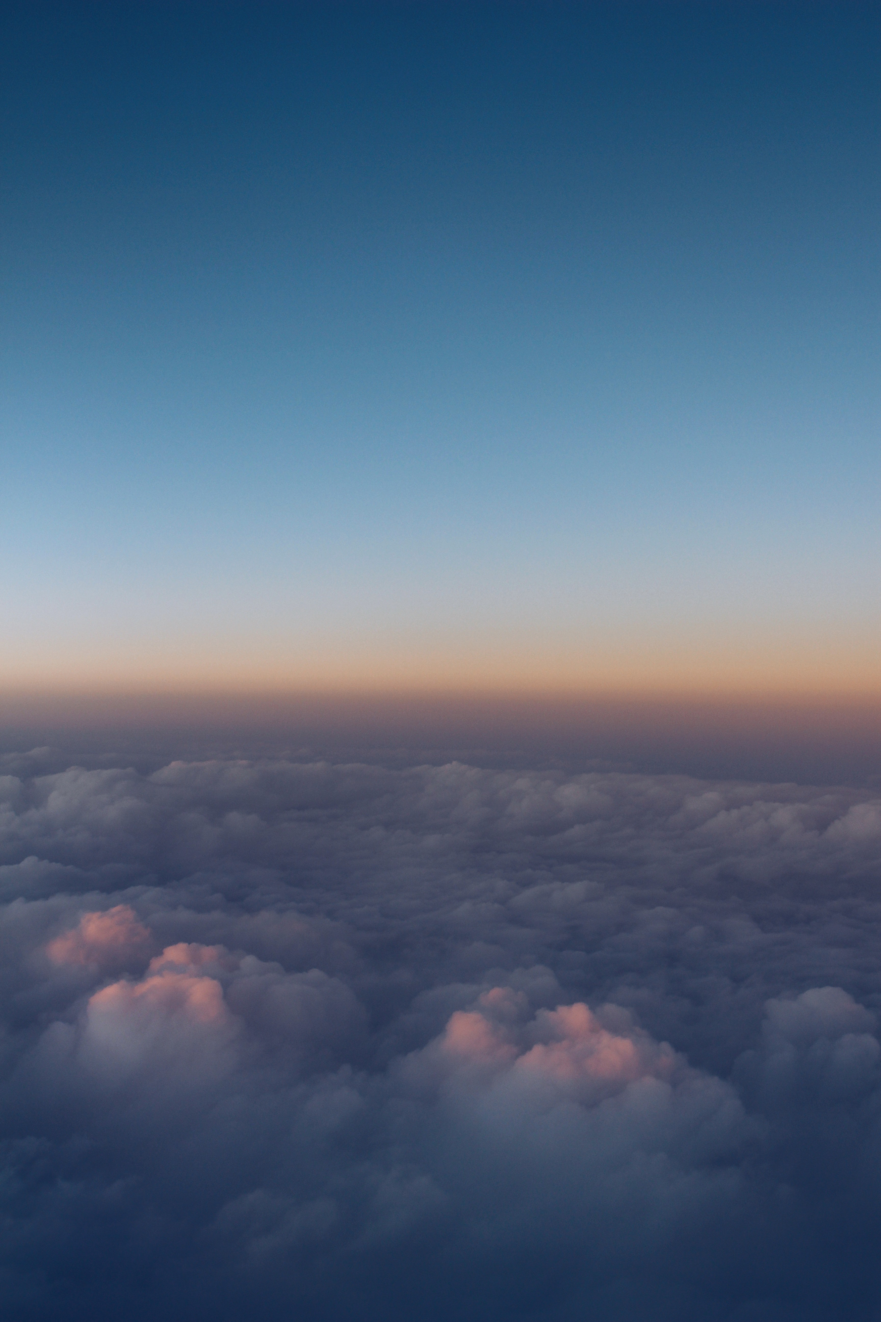 A sea of clouds seen from above during sunset