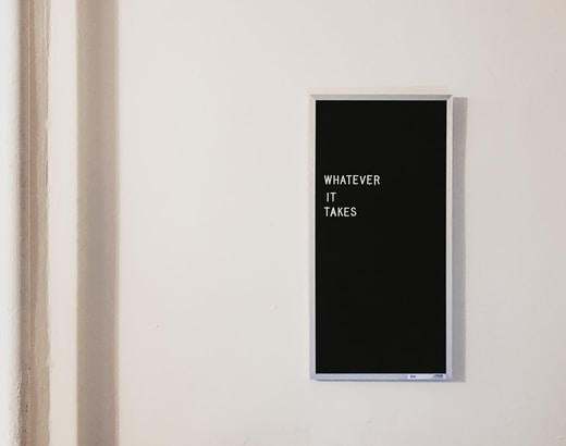 gray metal framed chalkboard with whatever it takes written