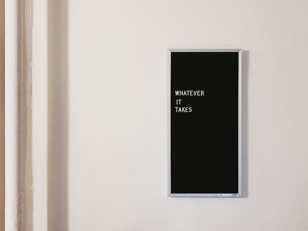 gray metal framed chalkboard with whatever it takes written