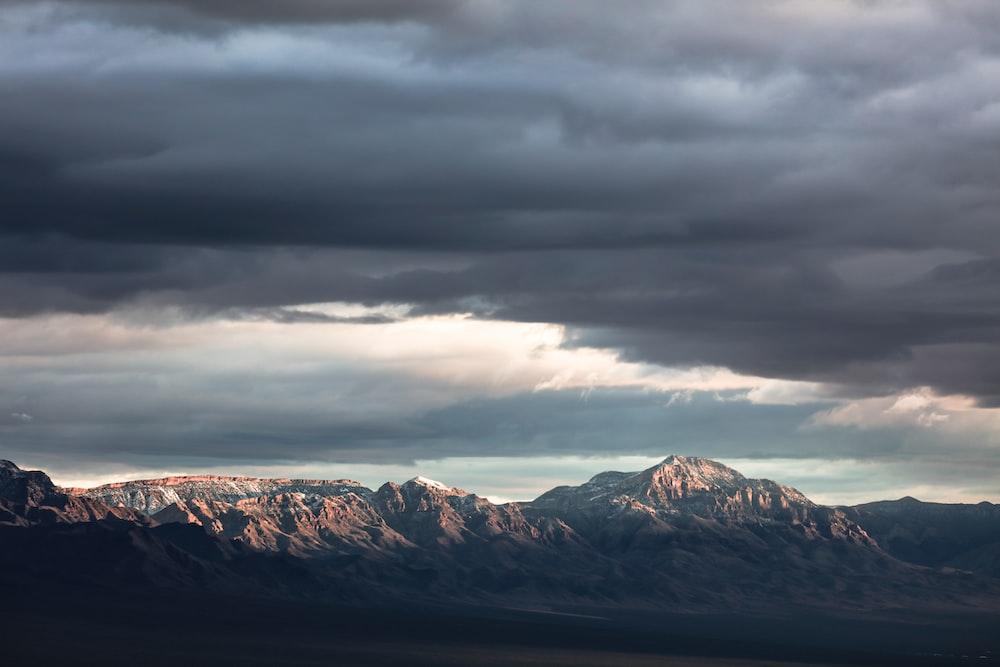mountain under nimbus cloud
