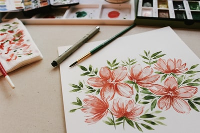 red petaled flower painting watercolor teams background