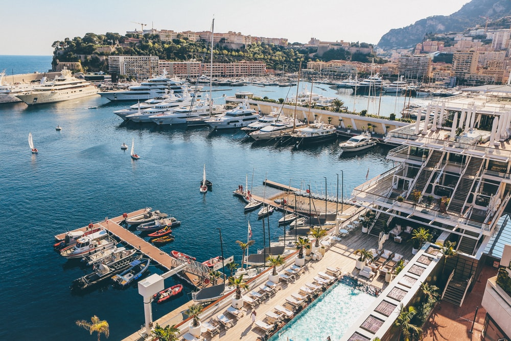 aerial photography of docks with yachts and motorboats during daytime