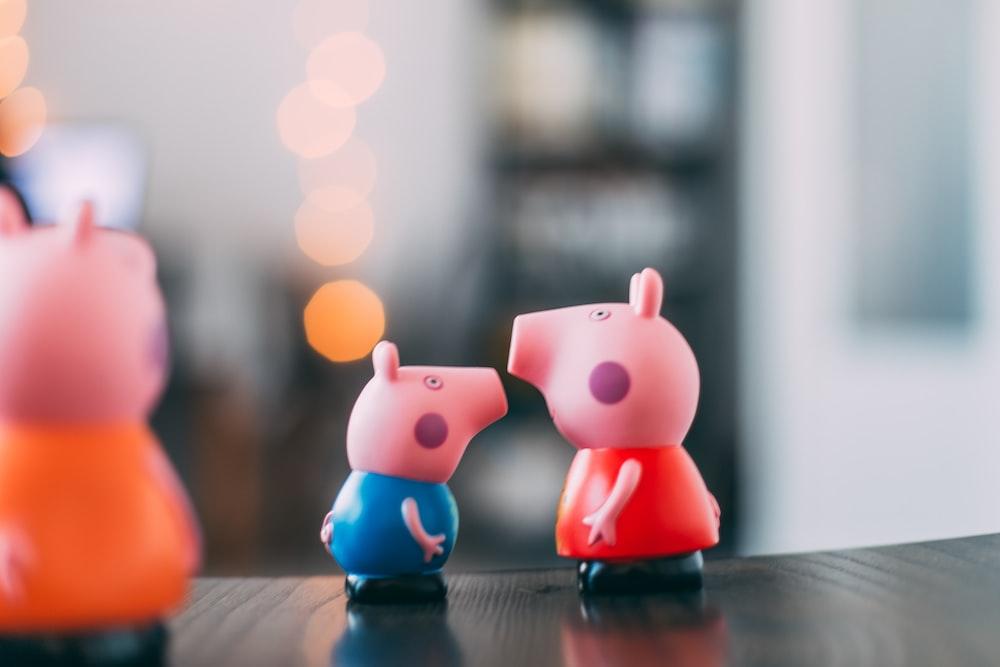 three pink pigs figurines