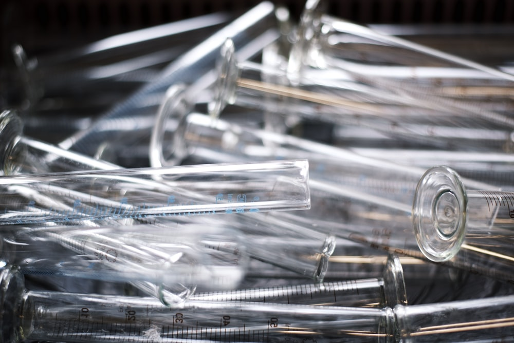 pile of clear measuring test tubes