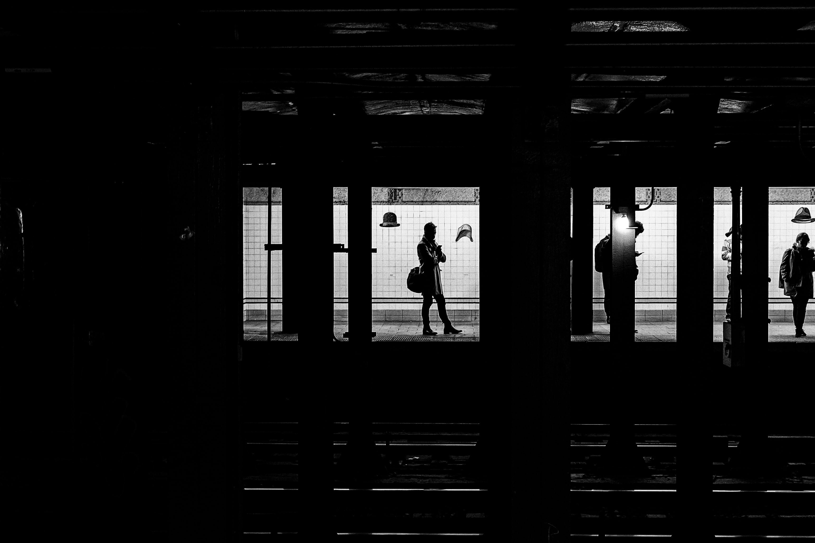 Black and white photo of people on the train station in the Flatiron District