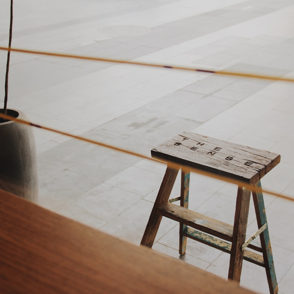 stool near brown vase