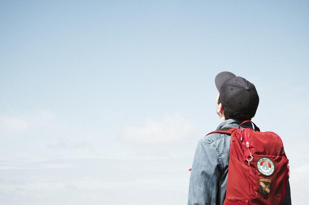man staring at white sky taken at daytime