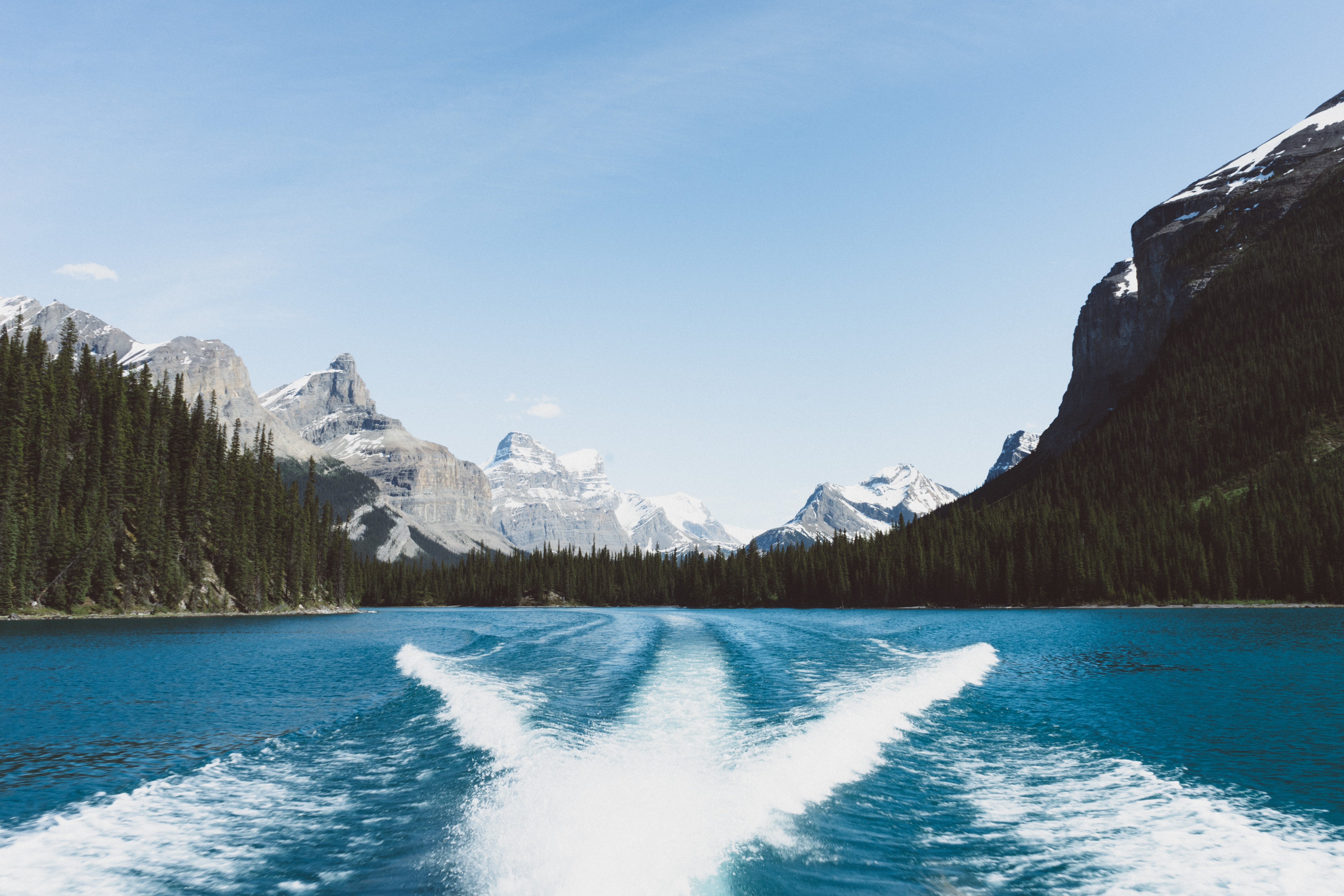 View from a boat on a wake left on the surface of a mountain lake
