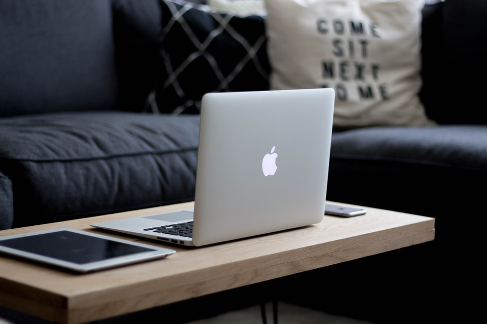 MacBook Air on brown wooden center table
