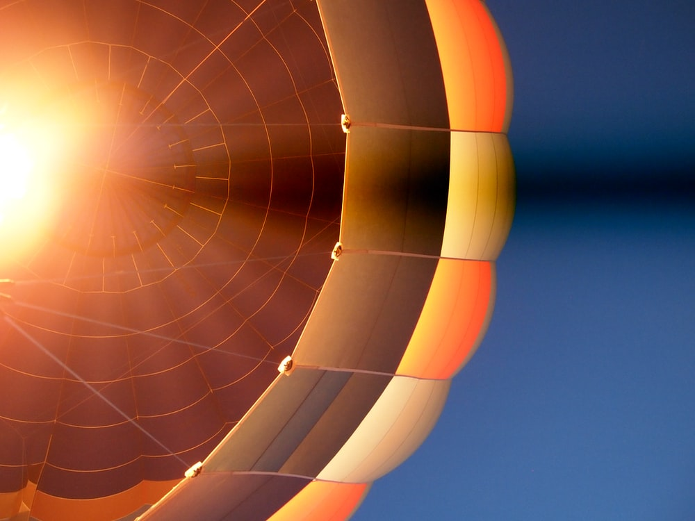 low angle photography of hot air balloon during day time