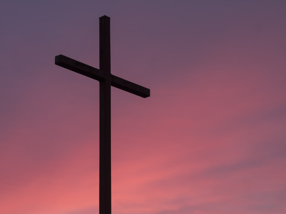 Cross pictures download free images on unsplash a cross against a pink and purple sky voltagebd Image collections
