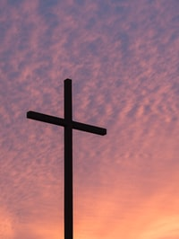 silhouette of large cross during daytime