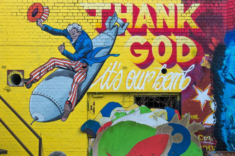 graffiti of uncle sam ride on gray missle