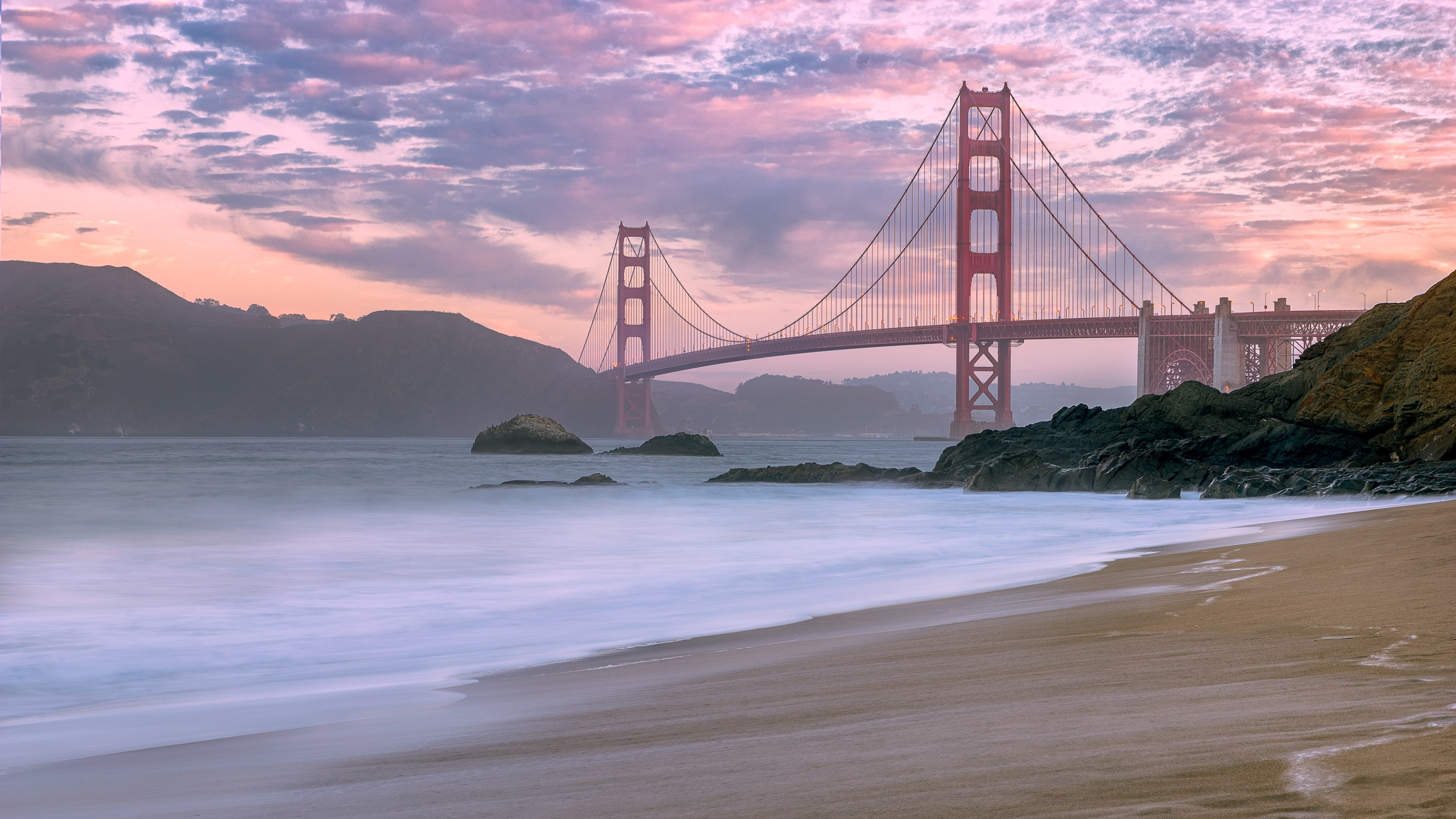 wide angle photo of Golden Gate Bridge under cloudy sky