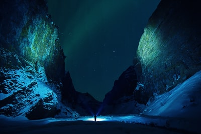 Strolling down the canyon. It was midnight and auroras were bursting, but i was stuck in the canyon, so i tried to make as much use as i can from the position where i was.  The idea fell on my mind to light the sides with the torches and another selfie came out :)