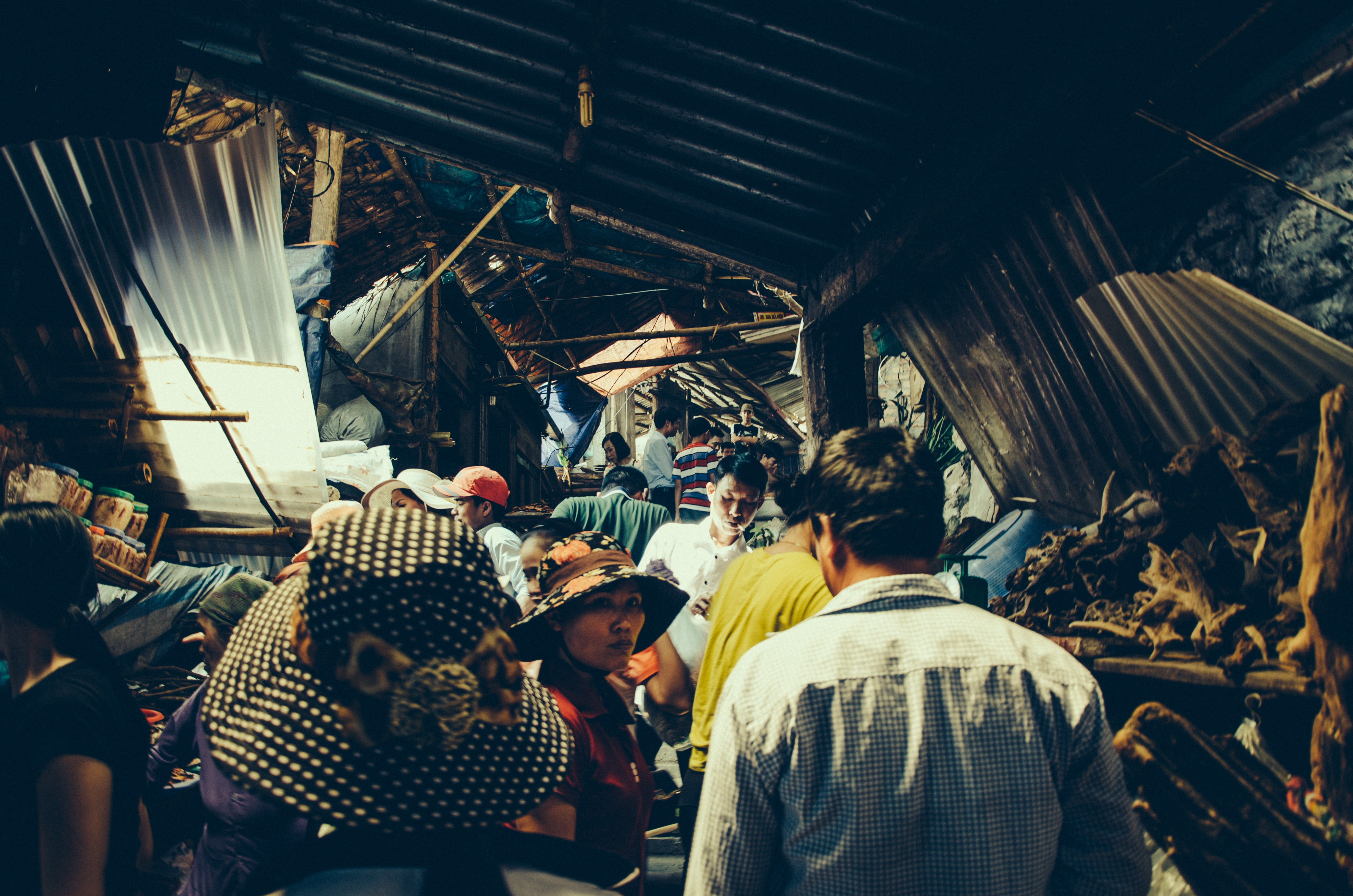People browsing goods at a market in Hoa Binh