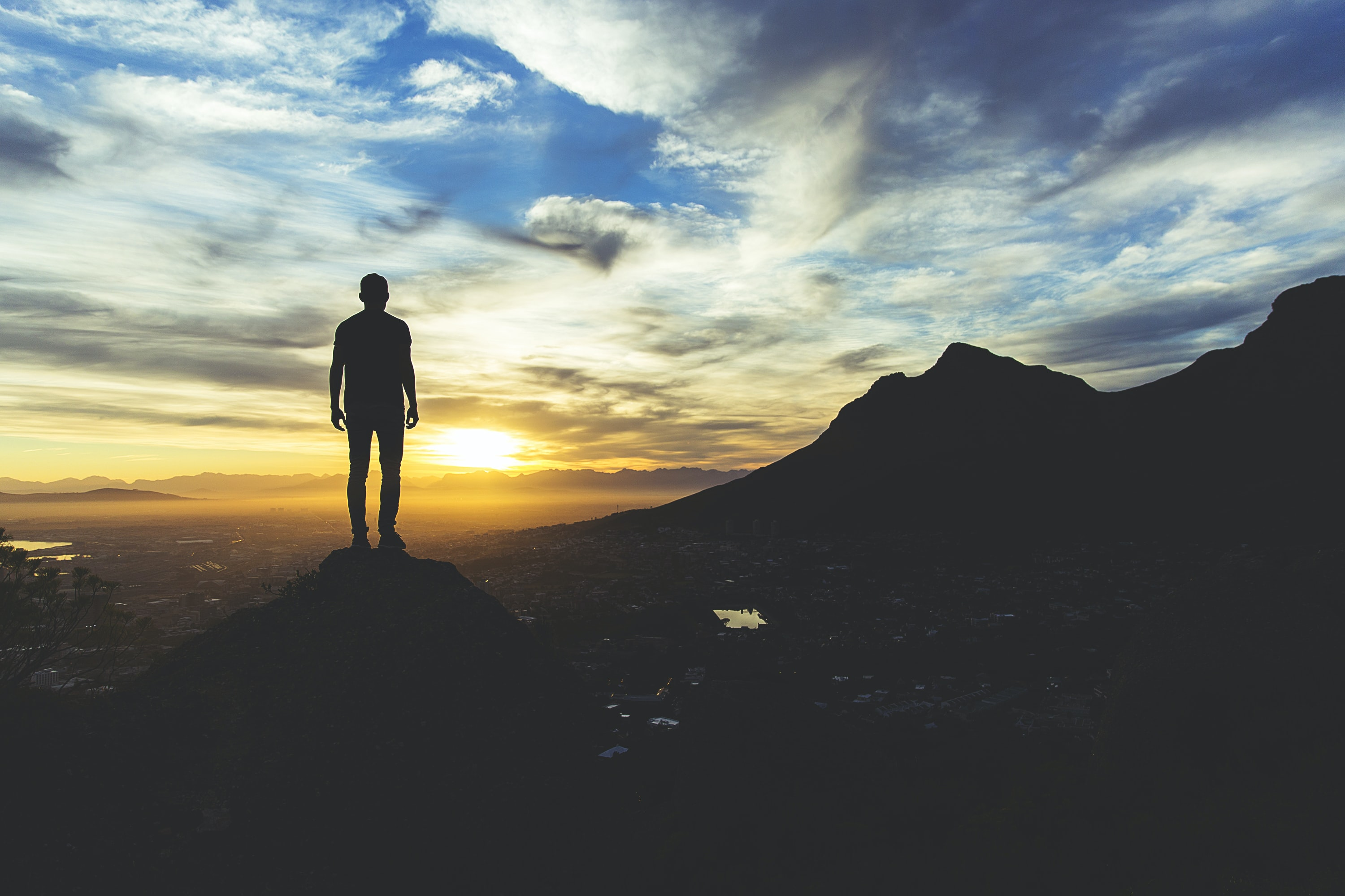 person standing at the top of mountain