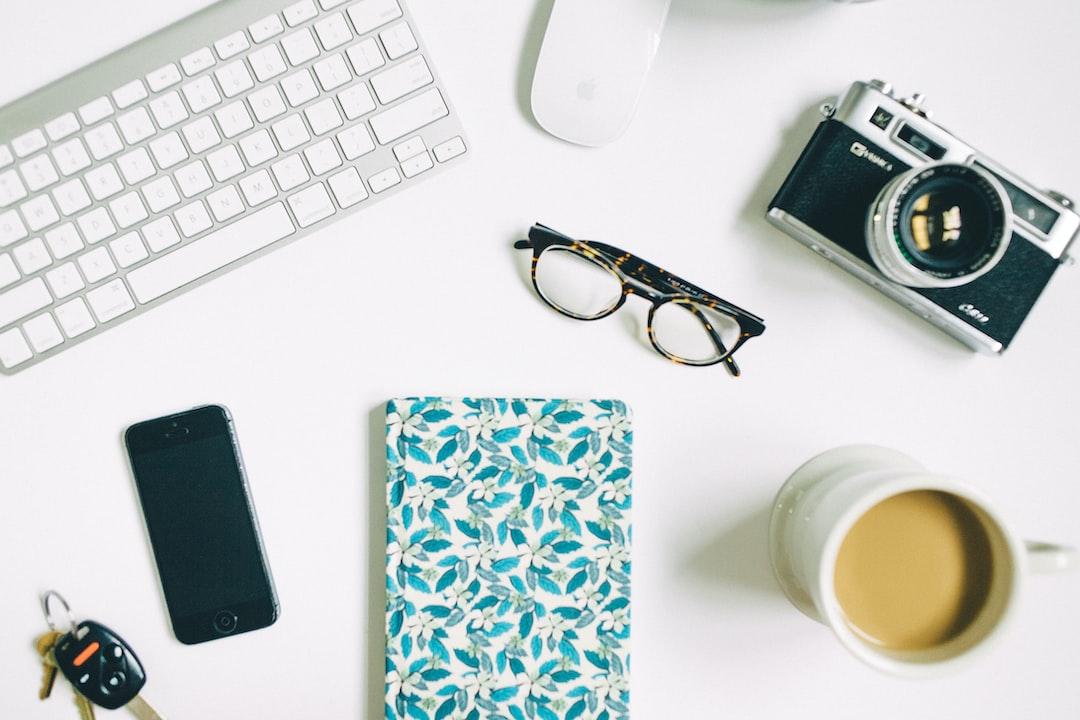 Camera keys notebook coffee
