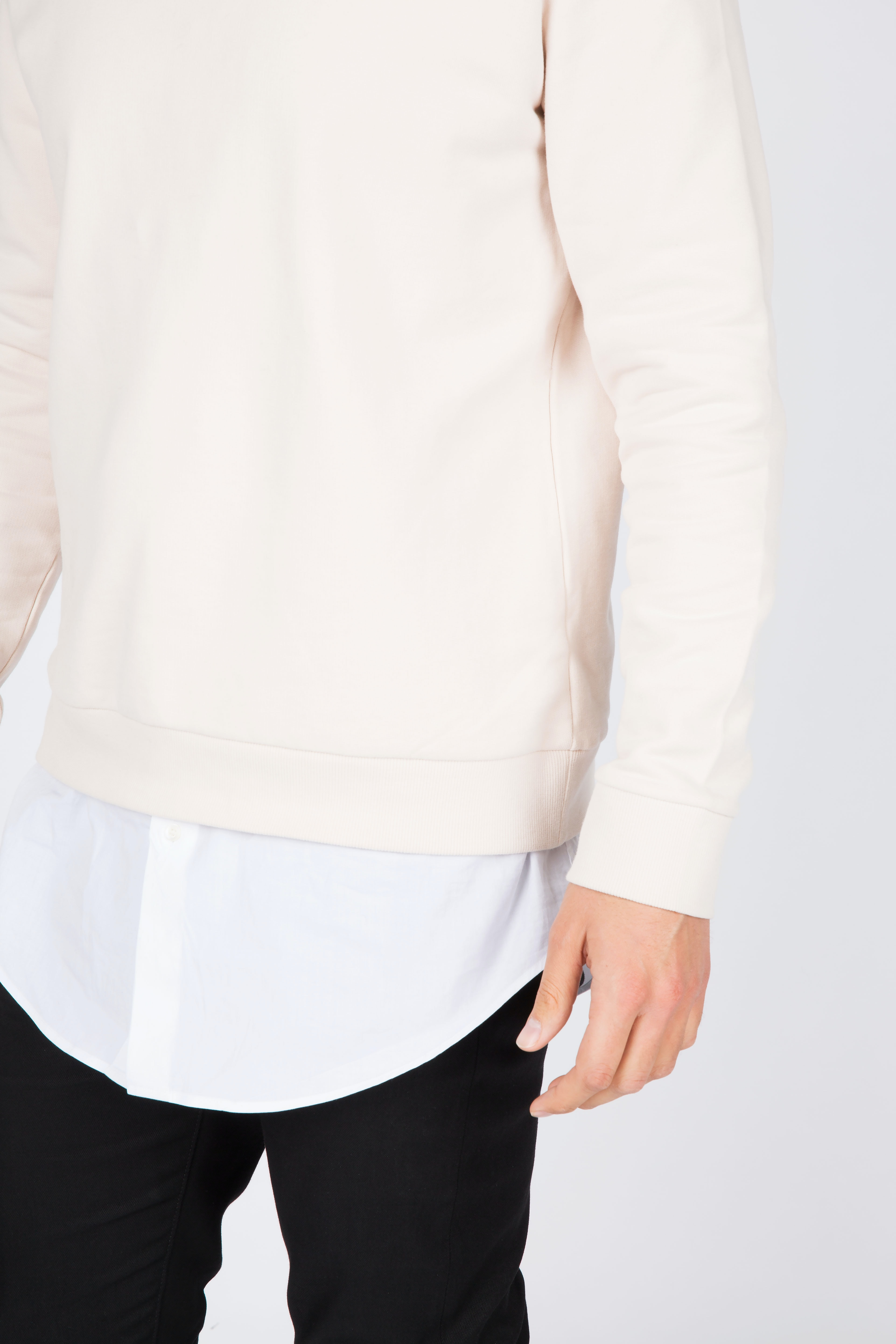 man in white long-sleeved shirt