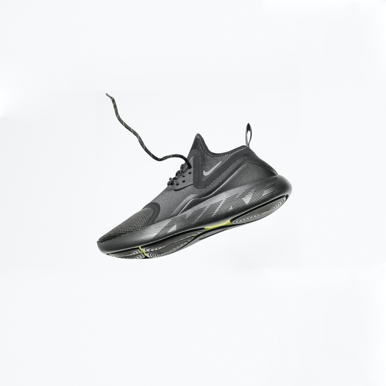 unpaired gray Nike running shoe