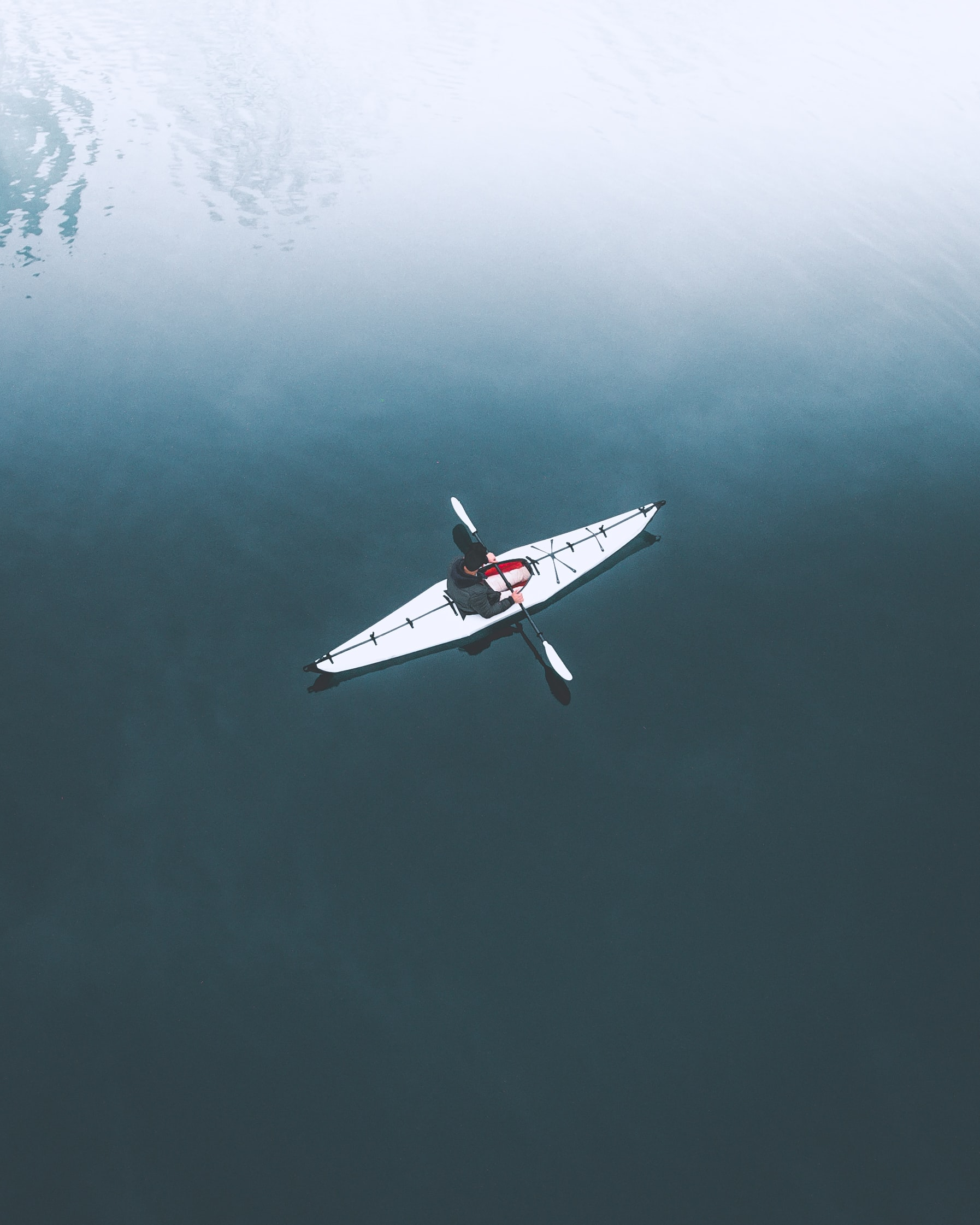 Drone shot of a lone kayaker in the water.