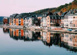 assorted-color of houses near lake