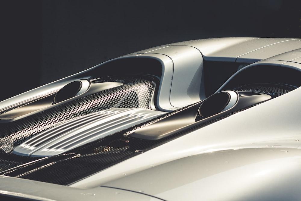 Rear view of a silver Porsche 918.