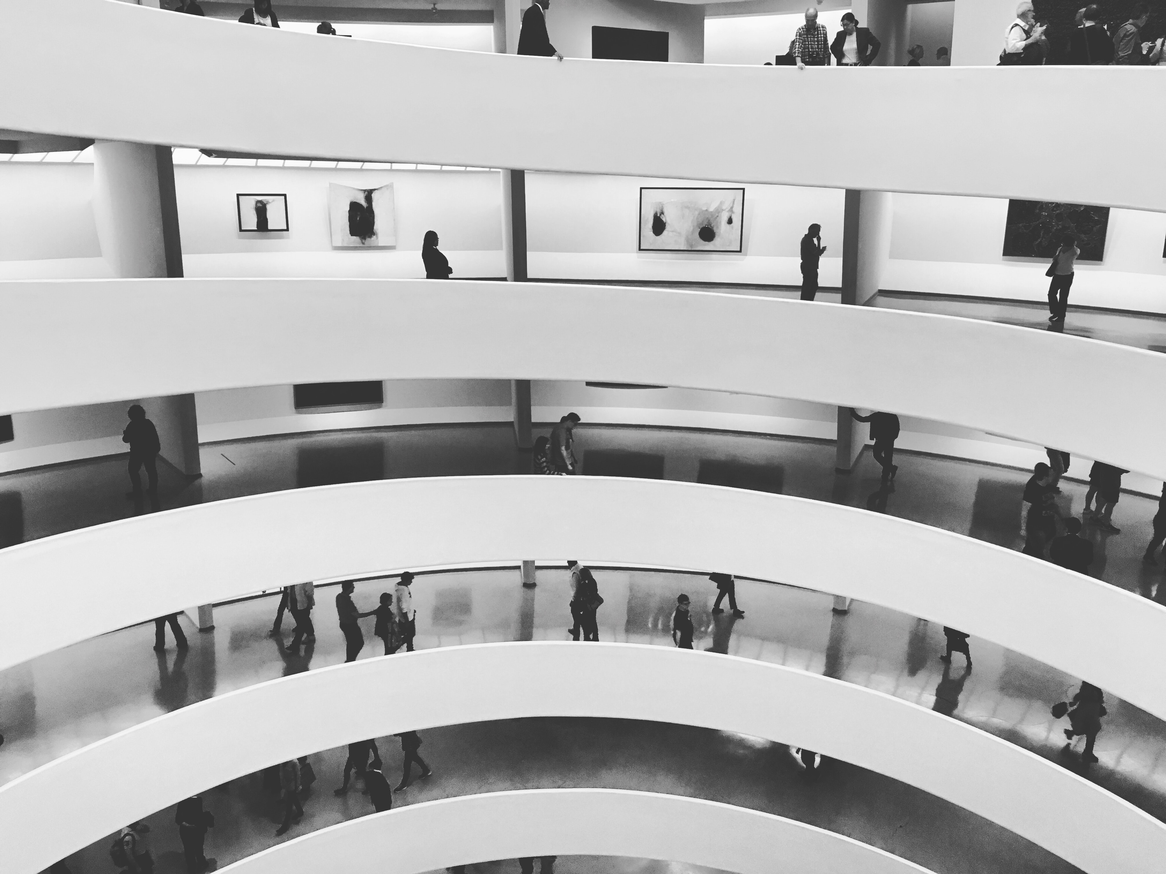 A black-and-white shot of multiple building floors seen from a terrace