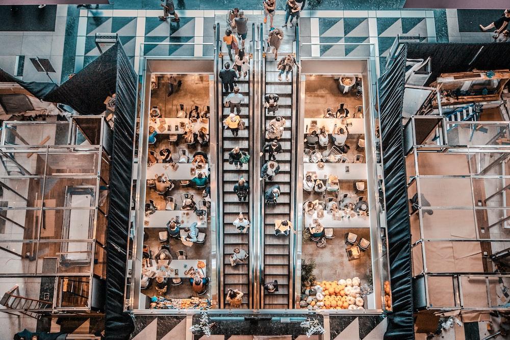 birds eye photography of people walking in stair