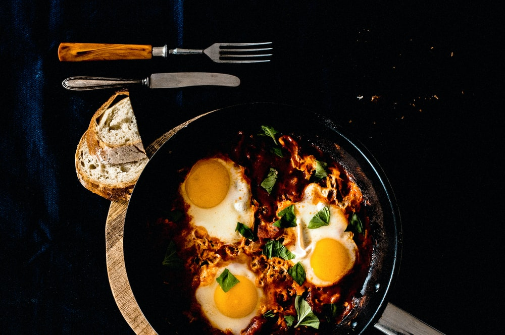 three fried eggs