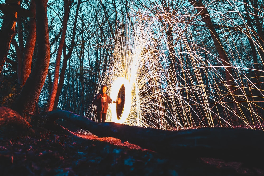 woman in the middle of forest steelwool photo