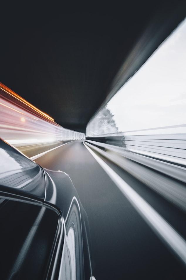 car blurred road view | credit Alessio Lin via unsplash