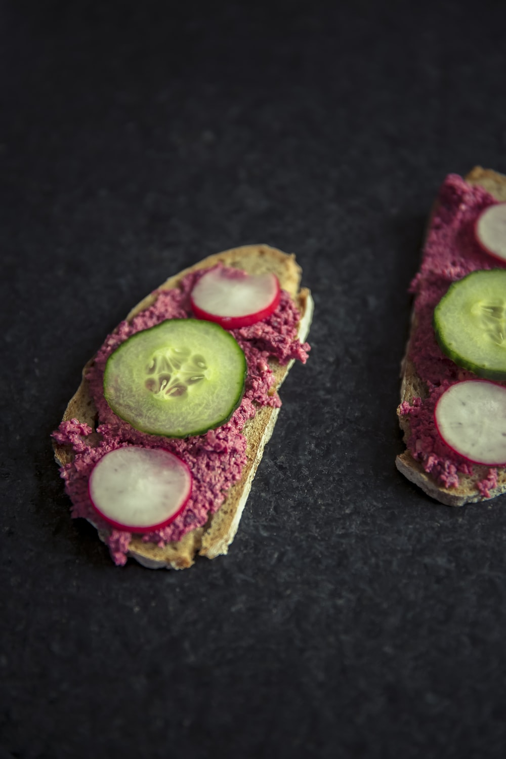bread with sliced dragon fruit and cucumber on top