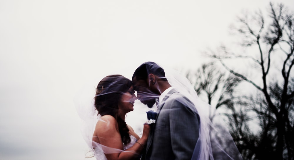 bride and groom facing each each other photo