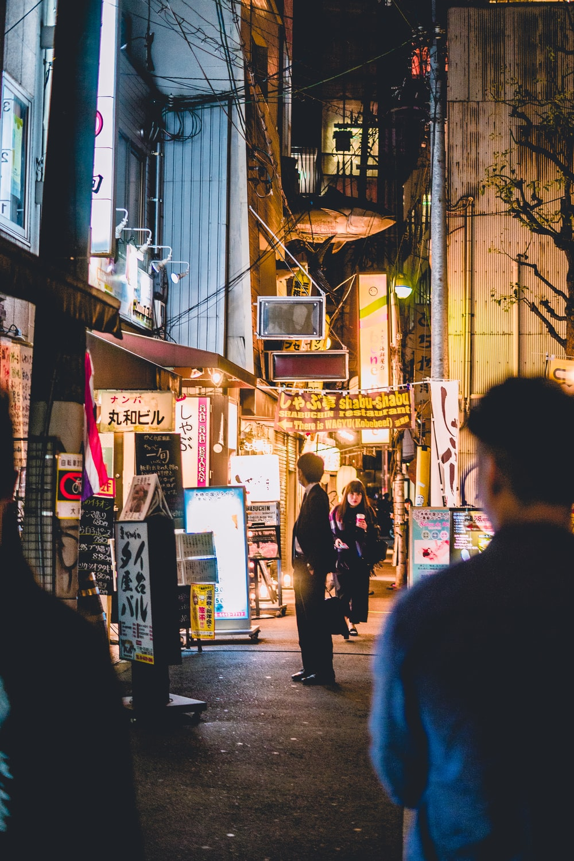 people walking beside building