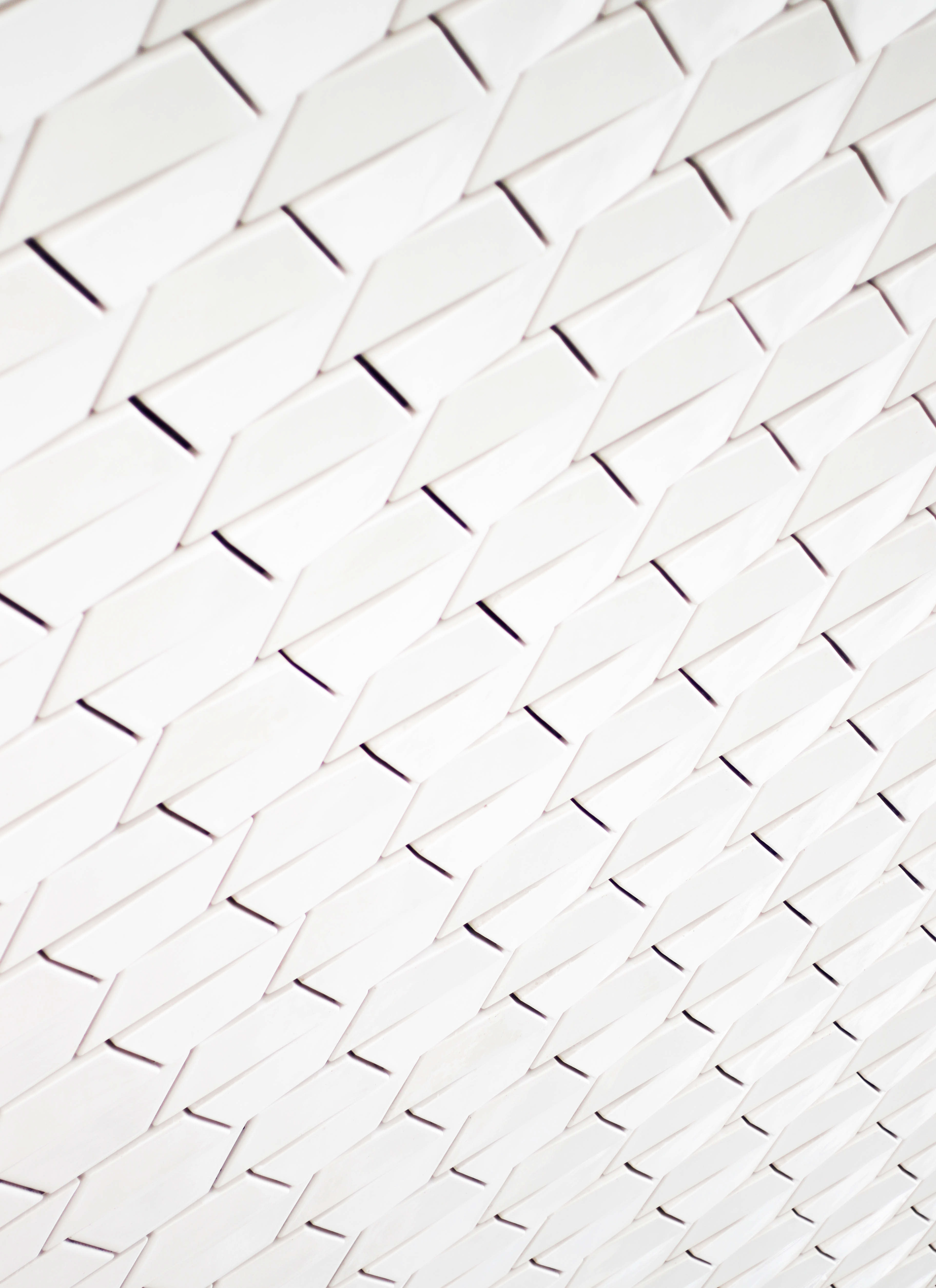 A pattern of white geometric shapes in a facade