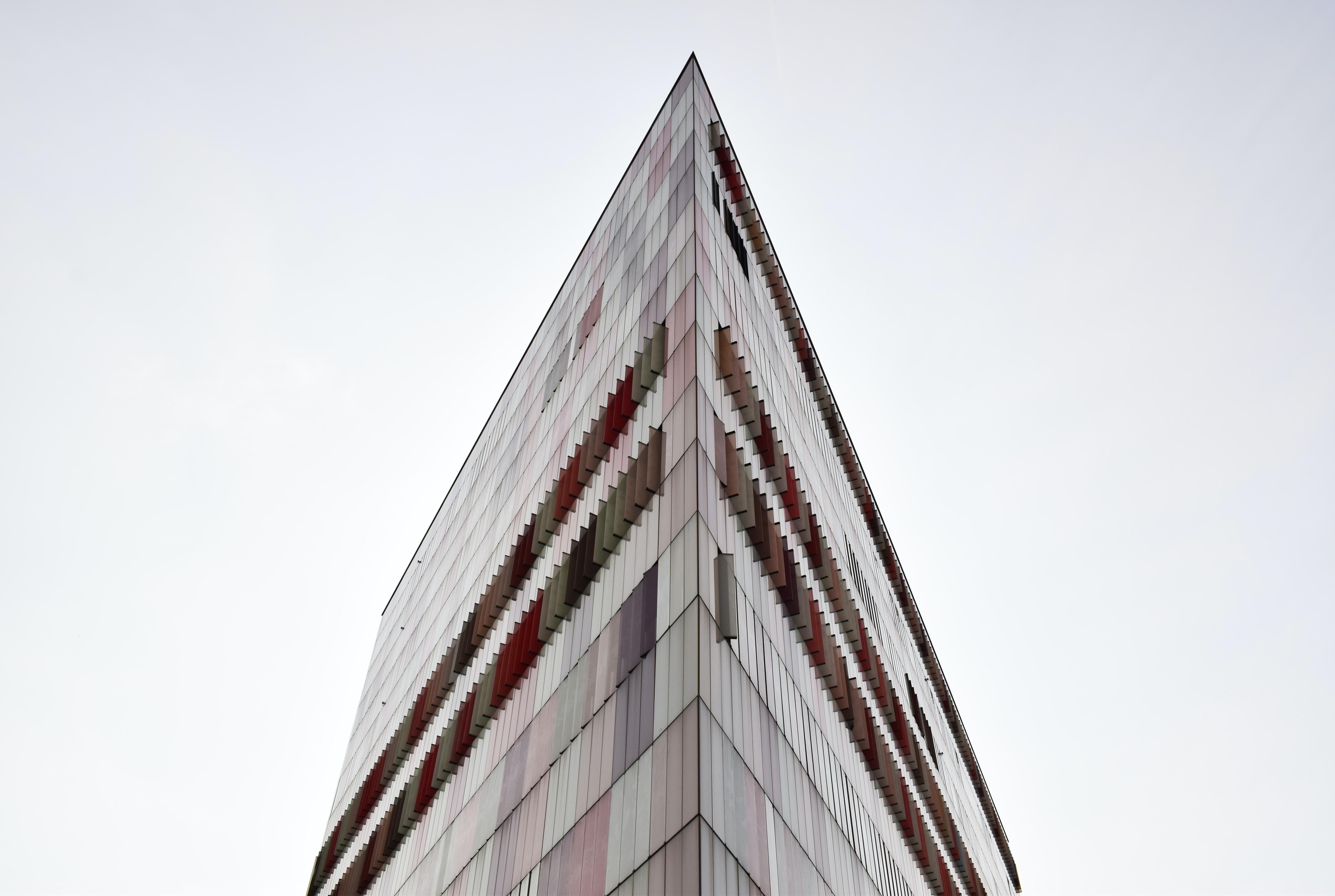 The sharp corner of a tall triangular skyscraper