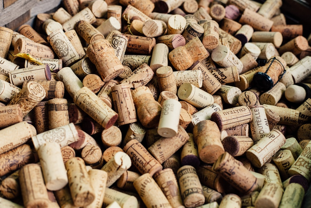 pile of brown cork lids