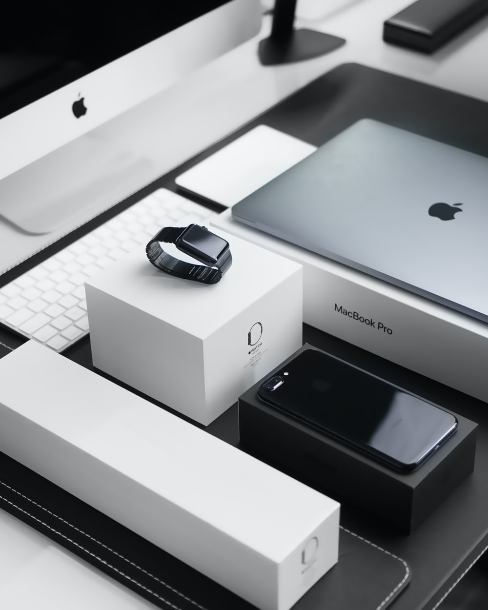 Many Apple products lovingly on display with their original packaging