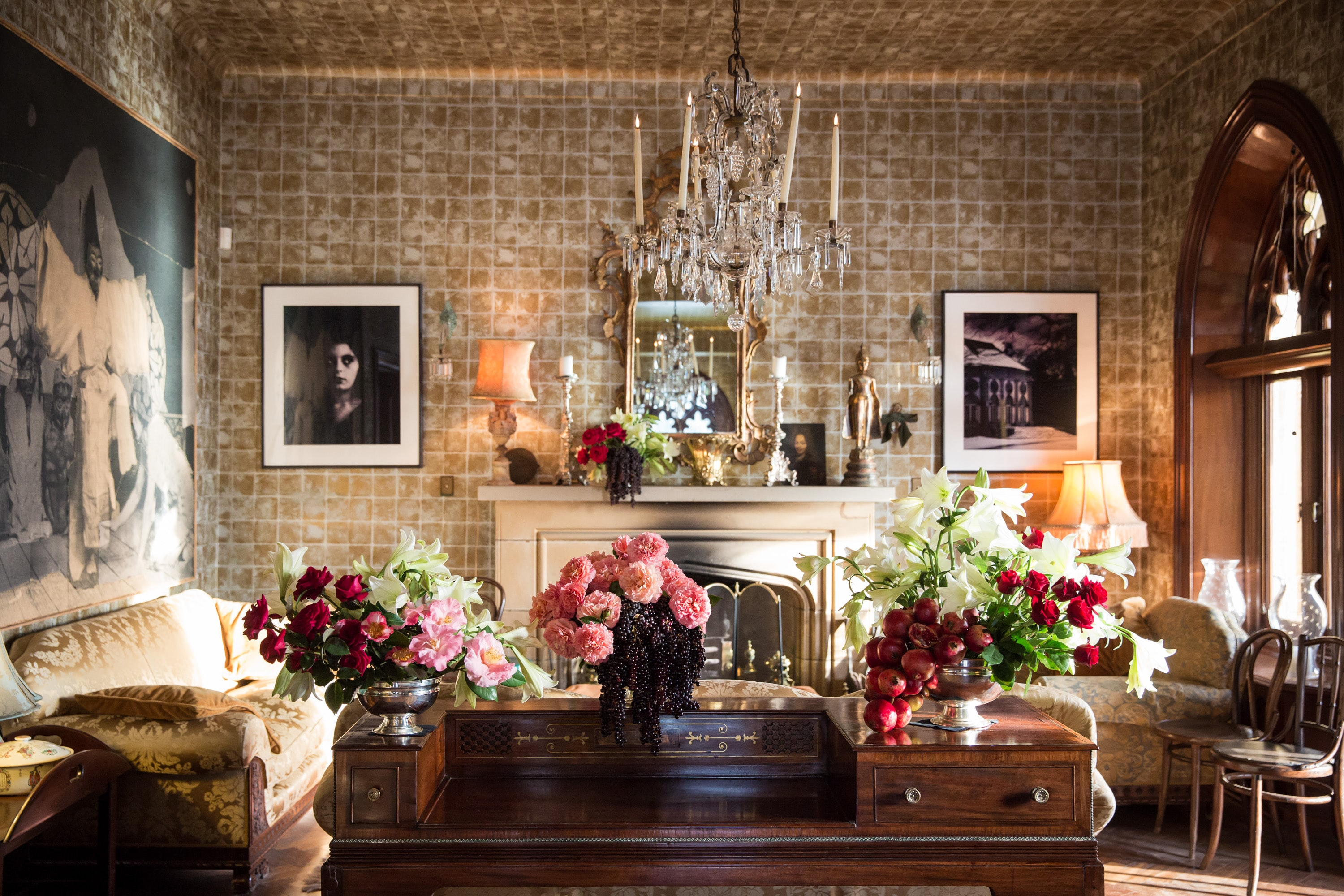 Classic antique residential interior with flowers on wooden table, chandelier and wall art in Sydney
