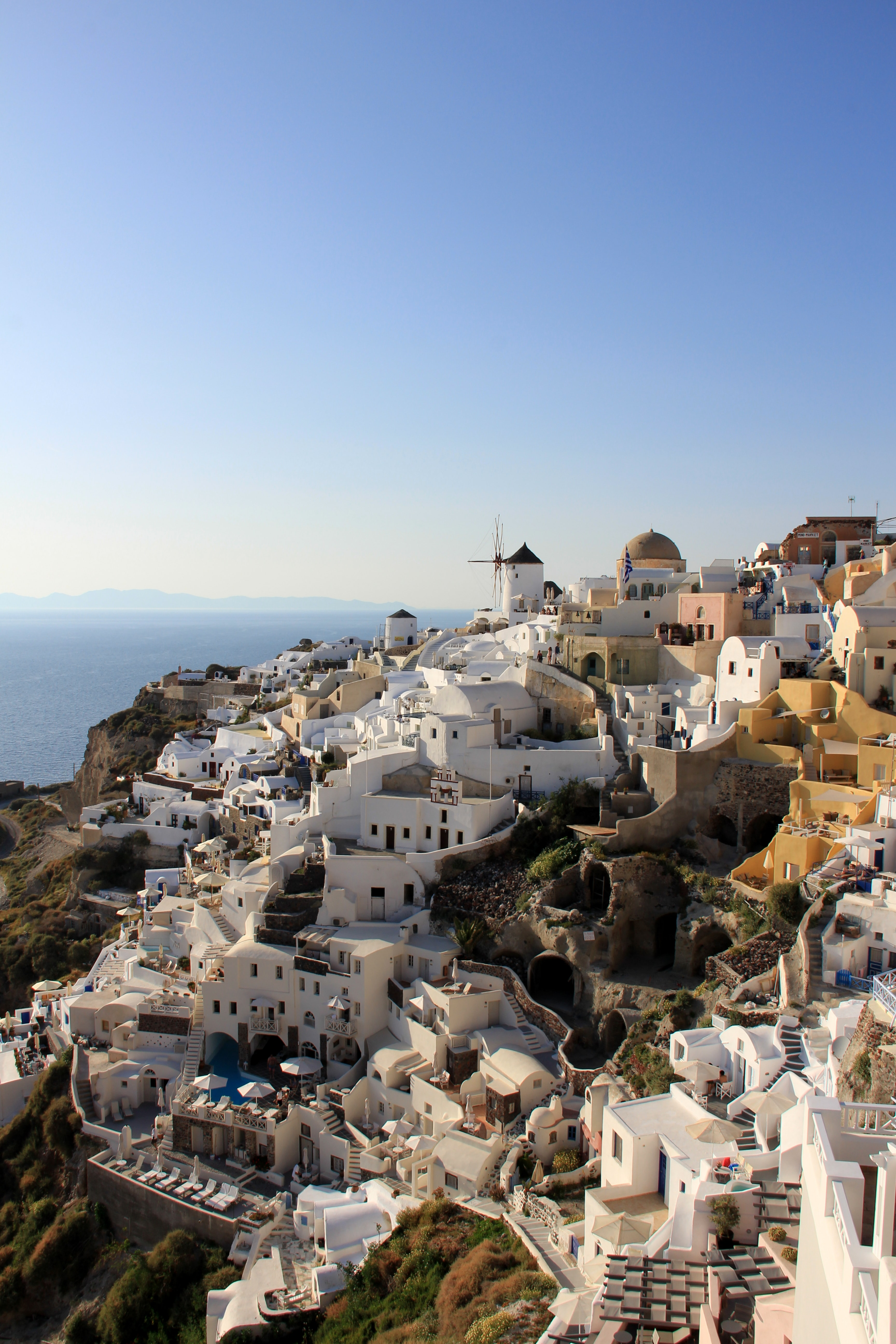 White-painted Mediterranean houses on a slope on Santorini island