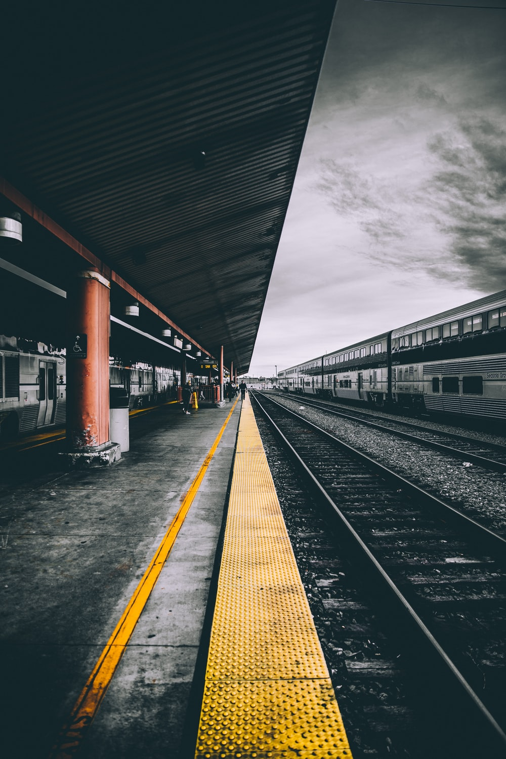 selective color photography of train railways