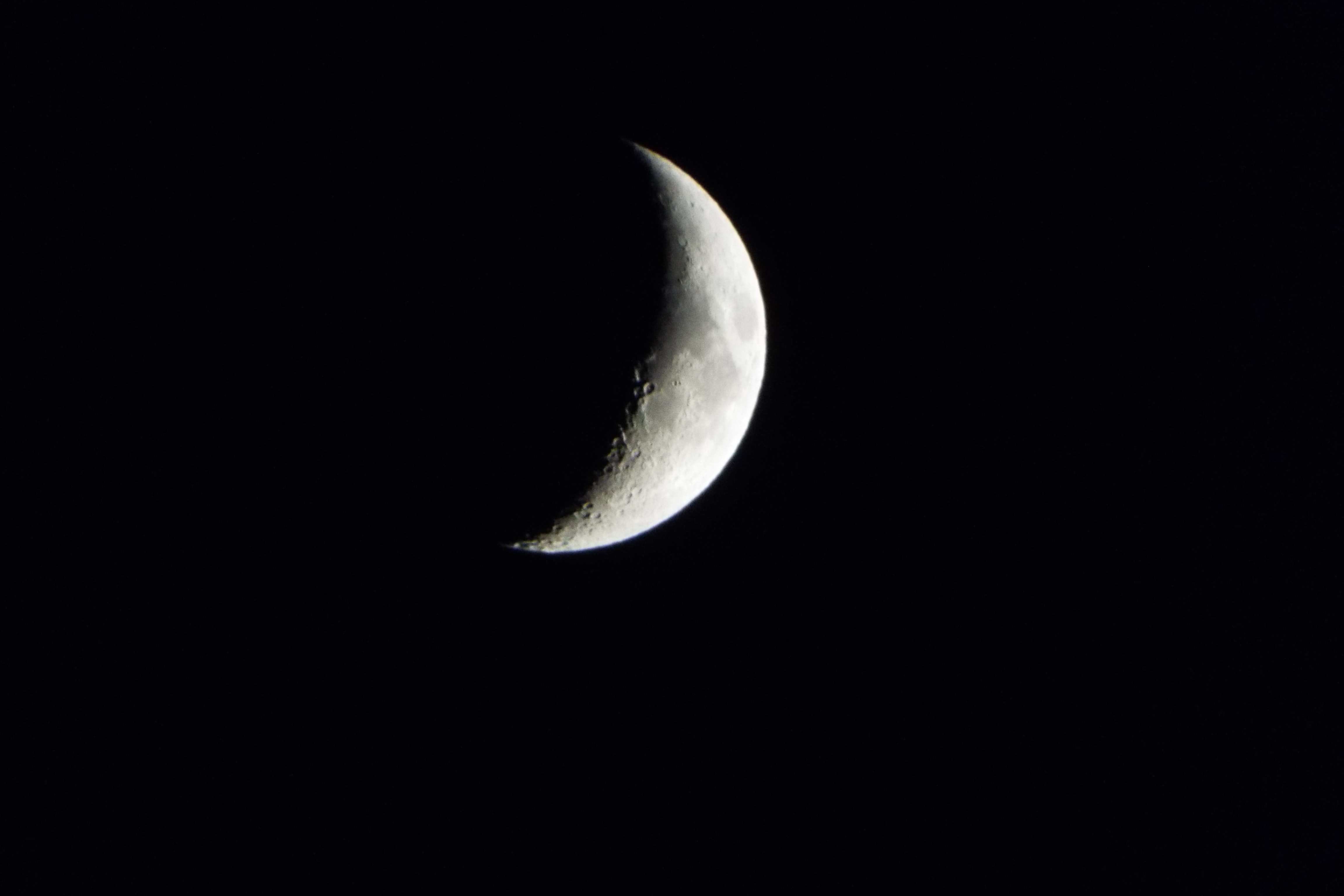 The moon appearing as a crescent during the eclipse at Rainham