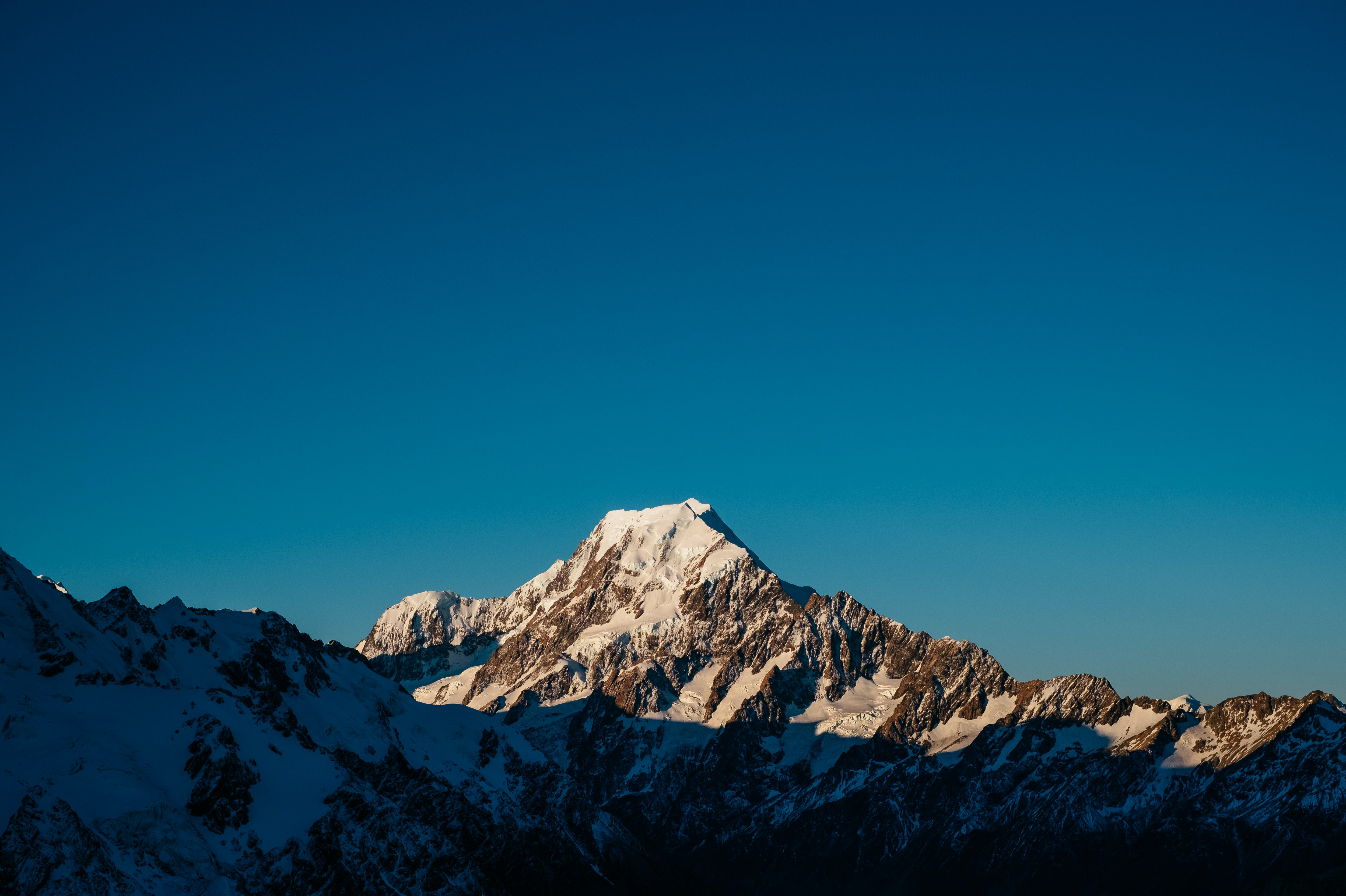 The tall Mount Cook silhouetted against a blue sky