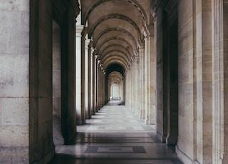 photo of gray hallway during daytime